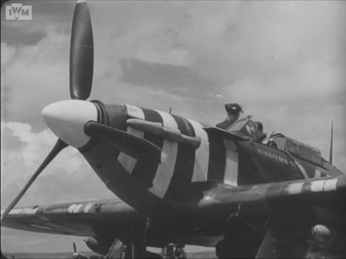 "A Hawker Hurrican of No 174 squadron RAF carrying the ""Rutter stripes""."