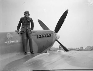 "Squadron Leader J. G. Sanders, poses on Supermarine Spitfire LF Mk IXb, MH819 ""Red Rose III"", at Squires Gate airport, Blackpool, Lancashire, before flying it to Biggin Hill, Kent, to join No. 485 Squadron RNZAF."